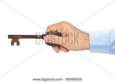 Hand with retro key isolated on white background