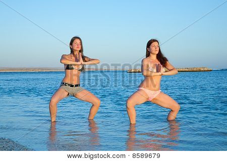 Girls Practicing Yoga  During Sunrise