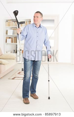 Man  with crutches, rehabilitation after injury