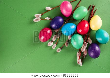 Colored Eggs And Willow Branches On A Green Background