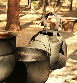 image of kettles  - Old kettle in camping - JPG