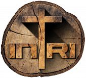 foto of inri  - Wooden Christian cross on a section of tree trunk with text INRI Jesus of Nazareth the king of the jews in Latin - JPG