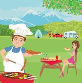 picture of veal meat  - couple outdoor grilling meat on picnic in the park  - JPG