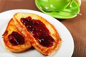 stock photo of french toast  - Breakfast with french toast with jam and cup of coffee - JPG