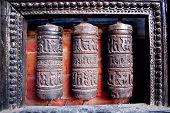 stock photo of mantra  - Metal drums inscribed with mantras  - JPG