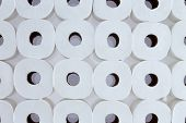 image of toilet  - Full frame background pattern of white toilet paper rolls arranged in neat rows viewed from above  - JPG