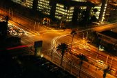 stock photo of traffic signal  - traffic turning at a light signal at night - JPG