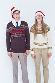 picture of sad christmas  - Sad geeky hipster couple on white background - JPG