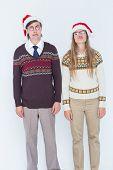 stock photo of sad christmas  - Sad geeky hipster couple on white background - JPG