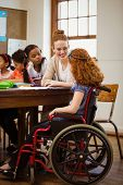 image of pupils  - Teacher helping a disabled pupil at the elementary school - JPG