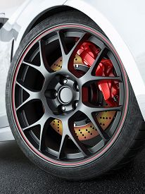 stock photo of race track  - Close tuned car wheel with red - JPG