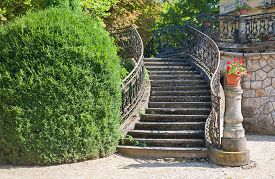 image of stairway  - Old stone stairway of a palace with wrought iron banister in a park - JPG