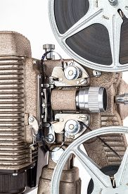 stock photo of mm  - Close up view of Vintage 8 mm Movie Projector with Film Reels - JPG