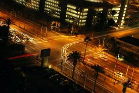 stock photo of traffic signal  - traffic turning at a light signal at night - JPG