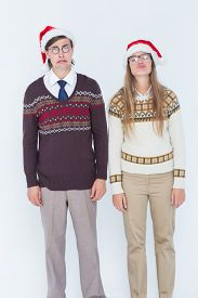 image of sad christmas  - Sad geeky hipster couple on white background - JPG