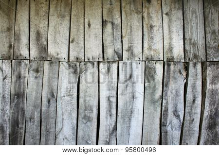 Wooden wall texture, wood background with knots and nails