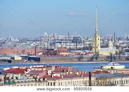 ST. PETERSBURG, RUSSIA - MARCH 5, 2015: Spire of Peter and Paul Cathedral over the cityscape. Built between 1712 and 1733, it is the first and oldest landmark in St. Petersburg