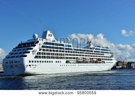 ST. PETERSBURG, RUSSIA - JUNE 27, 2015: Cruise liner Ocean Princess of Princess Cruises company departs from the Neva river. The ship provide luxury cruise for 680 guests
