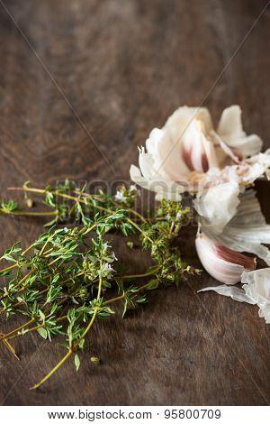 Garlic & Thyme Food Ingredients On Wooden Chopping Board