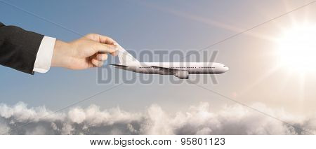 Businessman Hand Holding Airplane