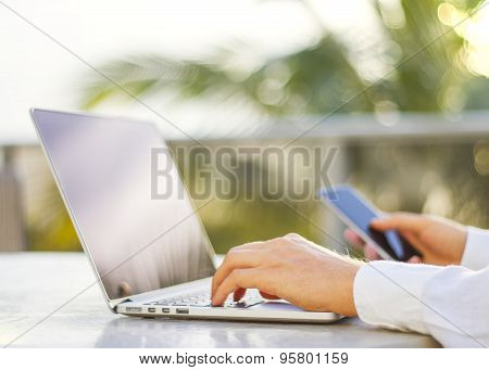 Businessman Typing On A Cellphone