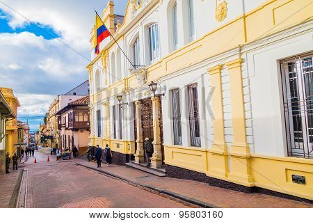 Beautiful yellow facade of typical spanish colonial architectural bigger townhouse in charming red p