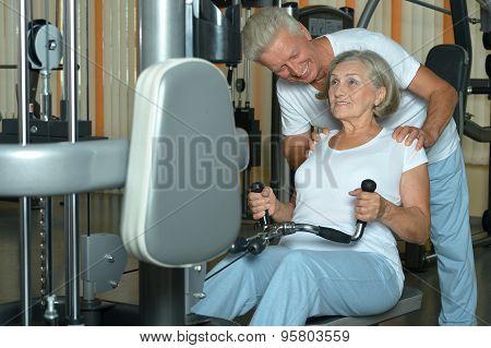 Senior couple exercising in gym