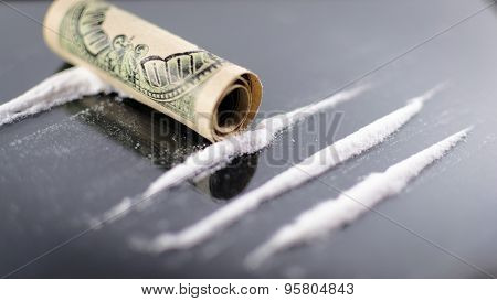Cocaine Lines And Rolled Up 100 Dollar Bill