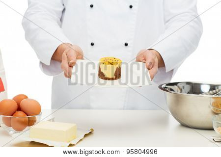 cooking, profession, haute cuisine, food and people concept - close up of male chef cook baking dessert