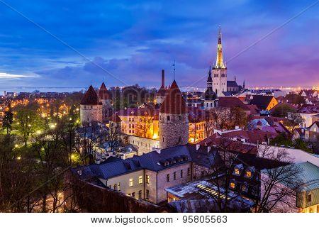 Aerial view of Tallinn Medieval Old Town illuminated in night, Estonia