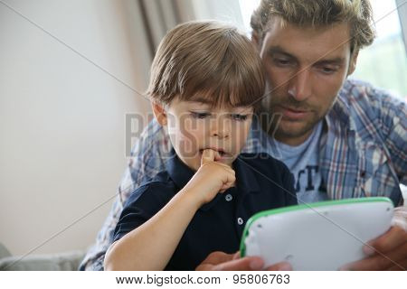 Daddy with kid playing with video game player