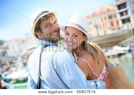 Portrait of cheerful couple in summer vacation at seaside resort