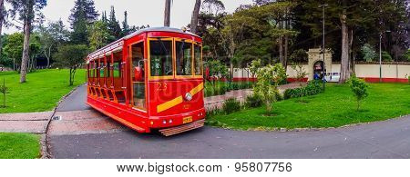 Old red tram serving as part of tourist attractions in a park environment Bogota, Colombia