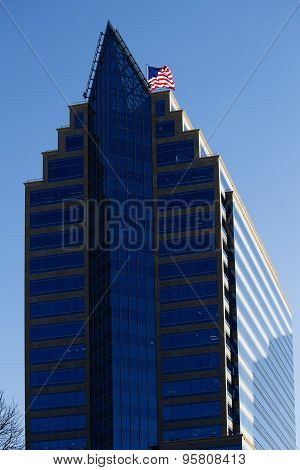 Office Building With Blue Windows And Us Flag