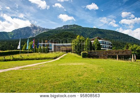 OBERSALZBERG, GERMANY - JUNE 22: Flag Lined Way Leading to Entrance of Kempinski Berchtesgaden Hotel, a 5 Star Luxury Resort Nestled in the Remote Alps on June 22, 2015 in Obersalzberg, Germany