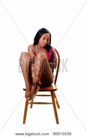Attractive Black Woman Sitting On Chair Red Bikini