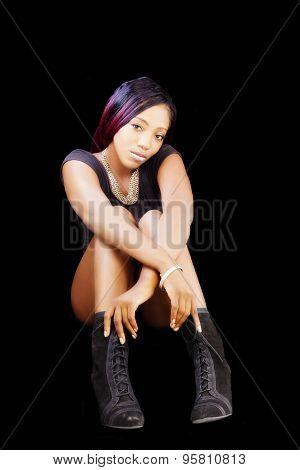 African American Woman Sitting In Black Leotards