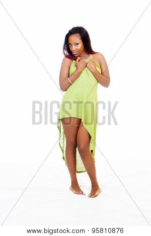 Young Attractive Black Woman Standing Holding Up Green Dress