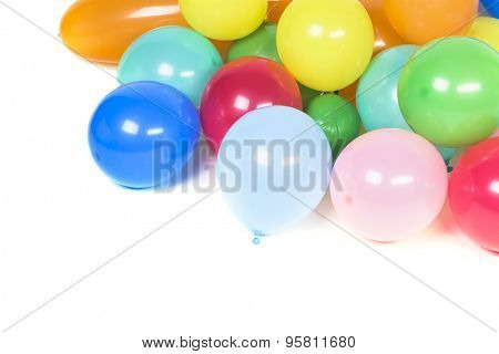 Many multicolored balloons isolated on white background