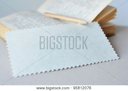 Blotter zigzag paper for notes on a book and pencil background