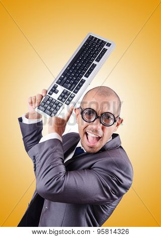 Nerd businessman with computer keyboard against gradient