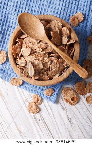 Bran Flakes In A Wooden Bowl Closeup. Vertical Top View