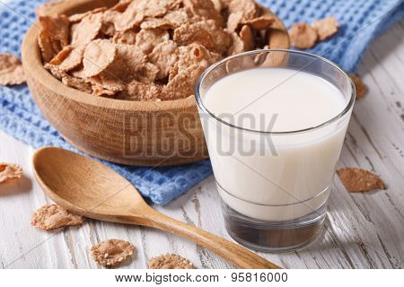 Fitness Breakfast: Bran Flakes And Milk Close-up. Horizontal