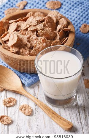 Fitness Breakfast: Bran Flakes And Milk Close-up. Vertical