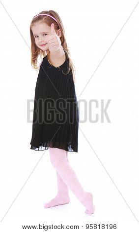 Fashionable little girl in a long black