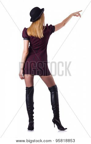 Young girl in leather hessian boots pressing virtual button isolated on white