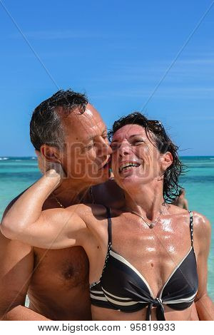 Sensual Couple Kissing On The Carribean Sea