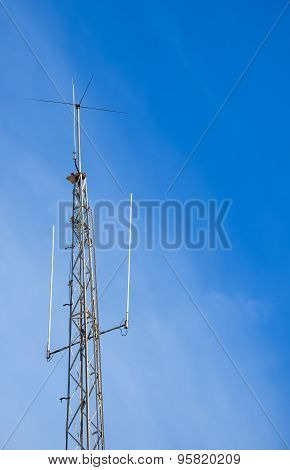 Relay Antenna Mobile Phone Television Internet Communication In Blue And Cloudy Sky