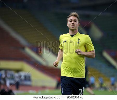 May 27, 2015 - Shah Alam, Malaysia: Tottenham Hotspur's Christian Eriksen jogs to warm up on the pitch before a friendly match in Malaysia. Tottenham Hotspur is on a Asia-Australia tour.