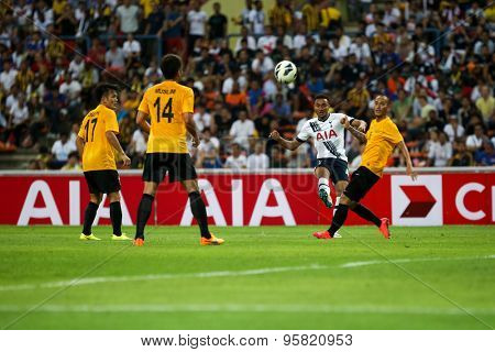 May 27, 2015- Shah Alam, Malaysia: Tottenham Hotspur's Grant Ward (white) passes the ball in the friendly match against the Malaysia (orange jersey). Tottenham Hotspur is on a Asia-Australia tour.